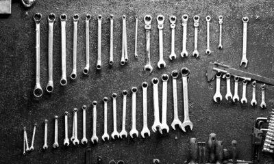 Decorative image of a set of tools, primarily wrenches, neatly aligned.