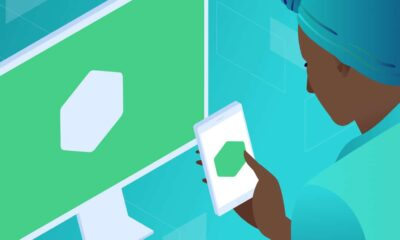 An illustration of a person looking at the same logo on both their computer screen and their mobile phone screen. Node.js apps, featured image.