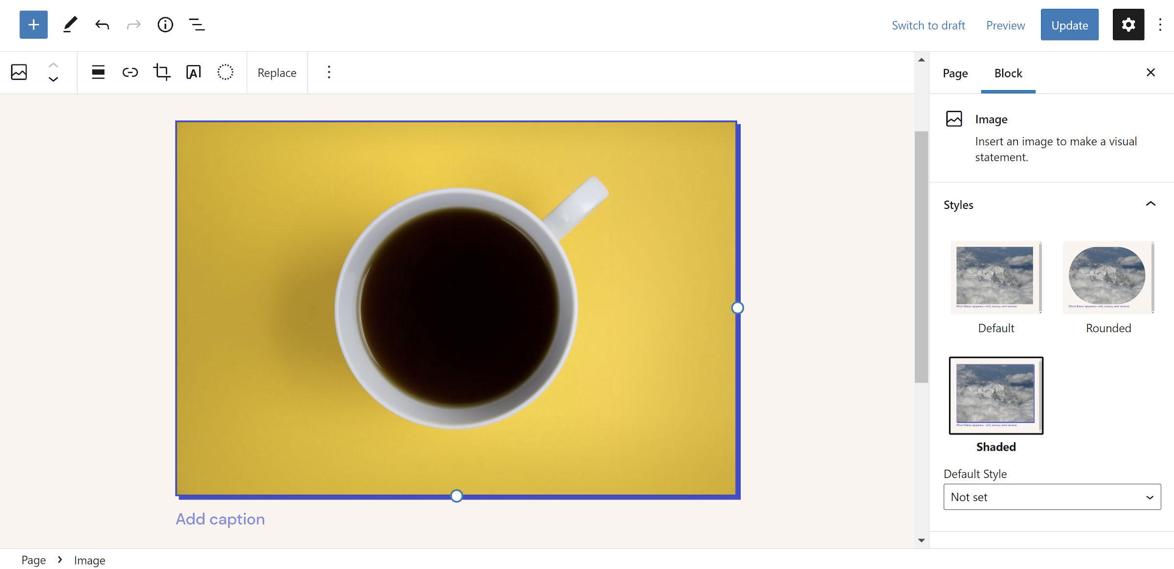 Blue drop-shadow on an image of a coffee in a mug in the WordPress editor.