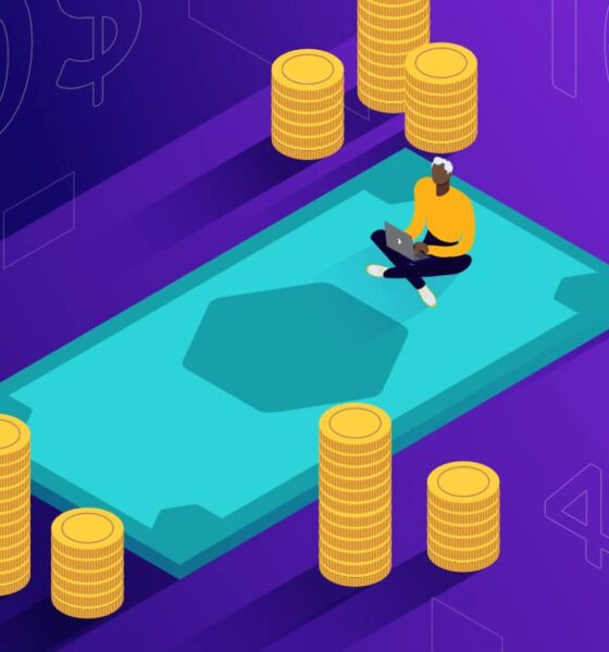 Illustration for Node.js developer salary showing of a person sitting cross-legged with a laptop on top of a huge green dollar bill, surrounded by giant stacks of gold coins.